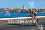 Brazil's Santiago Ascenco cycling hard at the 2013 Ironman 70.3…