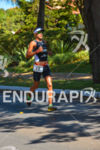 Former champion Santiago Ascenco running at the 2013 Ironman 70.3…