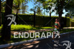 Amanda Stevens running among trees at the 2013 Ironman 70.3…