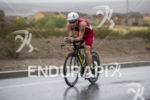 Paul Matthews riding in the rain at the 2013 Ironman…