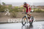 Jan Frodeno riding in the rain at the 2013 Ironman…