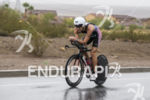 Kevin Collington riding in the rain at the 2013 Ironman…