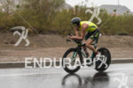 Greg Bennett riding in the rain at the 2013 Ironman…