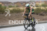Luke Mckenzie riding in the rain at the 2013 Ironman…