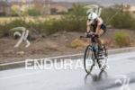 Annabel Luxford riding in the rain at the 2013 Ironman…
