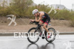Tenille Hoogland riding in the rain at the 2013 Ironman…