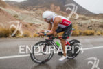 Terenzo Bozzone riding in the rain at the 2013 Ironman…
