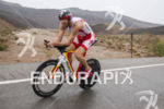 Bevan Docherty riding in the rain at the 2013 Ironman…