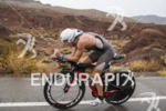 Josh Hamburger riding in the rain at the 2013 Ironman…