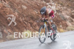 Lisa Norden riding in the rain at the 2013 Ironman…