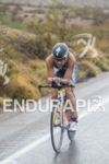 Angela Naeth riding in the rain at the 2013 Ironman…