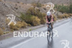 Melissa Hauschildt riding in the rain at the 2013 Ironman…