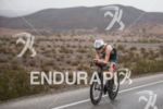 Svenja Bazlen riding in the rain at the 2013 Ironman…