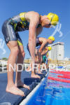 Cameron Dye prepares to dive into the water at the…