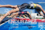 Cameron Dye (USA) dives into the pool with other pro…