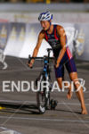 Jason Pederson comes into transition after the bike at the…