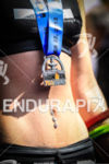 Rachel Kung (CHE) finisher medal at the 2013 Ironman 70.3…