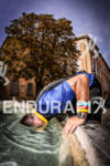 Participant puts his head in a fountain during the run…