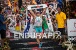 Mirinda Carfrae stands victorious at the 2013 Ironman World Championship…