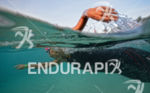 An age-group athlete swims to the start of the 2013…