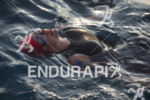 Age grouper Jennifer Harrington pauses before the swim start at…