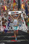 Mirinda Carfrae is victorious at the 2013 Ironman World Championship…