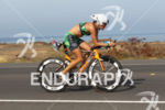 Ironman Amanda STEVENS (USA) competes during the bike portion of…