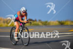 Caitlin Snow riding at the 2013 Ironman World Championship in…