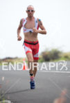 Bevan Docherty running at the 2013 Ironman World Championship in…