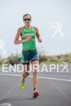 Linsey Corbin running at the 2013 Ironman World Championship in…