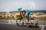 Pete Jacobs on bike passing Kona Airport at the Ironman…