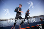 Pros exit the water at Ironman Arizona on November 17,…