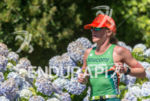 Sara Piampiano running thru the flowers path  at the 2014…