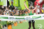 Dede Griesbauer cheering with the crowd at the 2014 Ironman…
