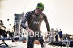 Andy Potts exiting the swim leg first at the Ironman…