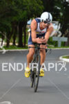 Timothy O'Donnell riding on the bike at the 2014 Ironman…