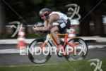 Tim Don riding fast on the bike at the 2014…