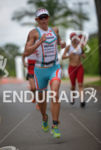 Mirinda Carfrae running fast at the 2014 Ironman 70.3 Brasilia…