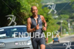 Deca Ironman champion Sergio Cordeiro running at the 2014 Ultra…