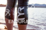 Athlete in a TYR wetsuit prepares for the start or…