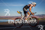 Andy Potts climbs out on bike at the  Ironman 70.3…