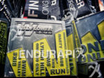 Medals await their recipients at the finish line at Wildflower…
