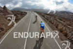 Athletes at national park Timafaya on the bike portion of…