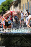 Age Group athlete refreshing in one of numerous fountains bordering…