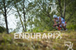Riding among tress at the 2014 Ironman Florianopolis in Florianopolis,…