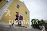Athlete running thru the church at the 2014 Ironman Florianopolis…