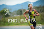Sara Gross running for victory aat at the 2014 Ironman…