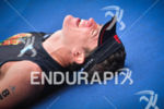 An athlete collapses after the finish line at the 2014…