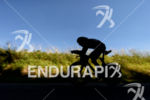 Silhouette of Sebastian Kienle on the bike at the 2014…