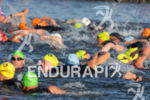 Athletes swim in the crowded waters at the Challenge Atlantic…